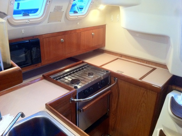 A newly cleaned galley aboard our new liveaboard sailboat Kingsley.