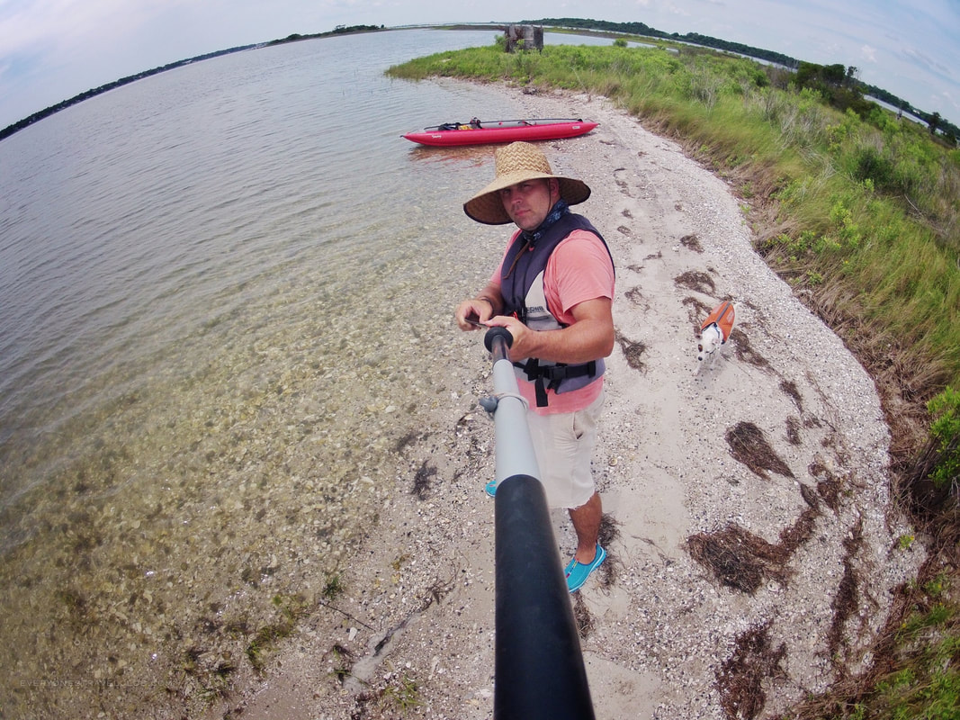 Gorpo selfie time with dog while kayaking near Emerald Isle.
