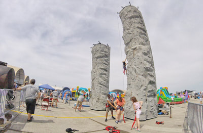 The kid fun zone rock climbing wall at the 2018 cherry point air show.