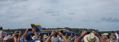 A blue angel passing the crowd at the 2018 MCAS Cherry Point air show