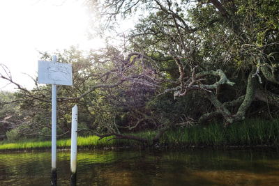 Old Oyster Bed lease signs in the Stump Sound near the Permuda Island Reserve