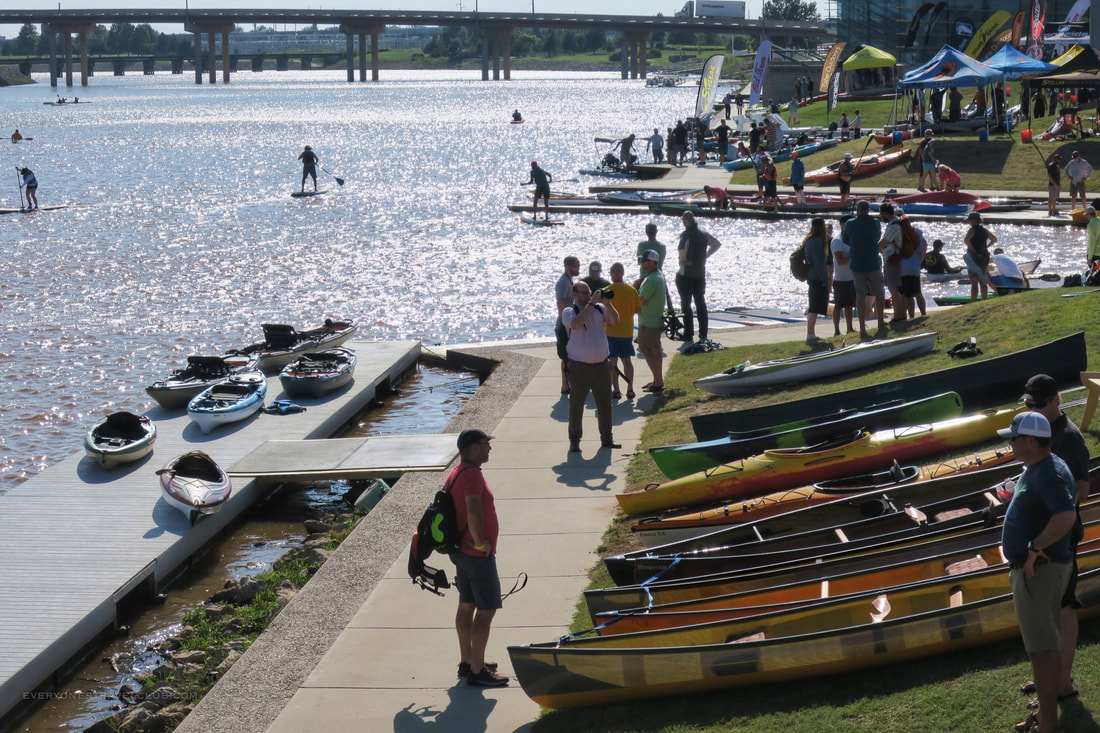 Retailers browsing kayaks at demo day at the Paddlesports Retailer Show in Oklahoma City, 2018