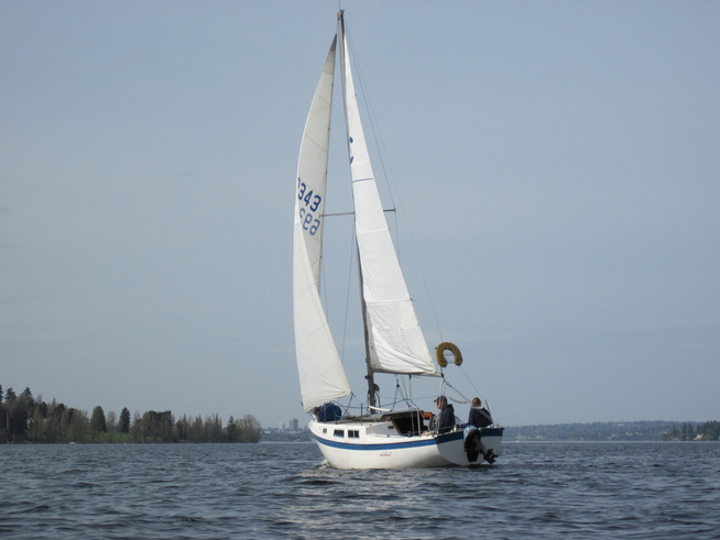 A sailboat on a downwind jibe just off of Mercer Island in Lake Washington