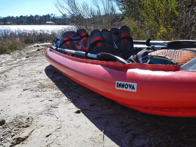 Launching an inflatable Innova kayak from the Queens Creek Road bridge