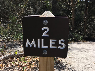 Mile marker on the seaside Elliot Coues Nature Trail.