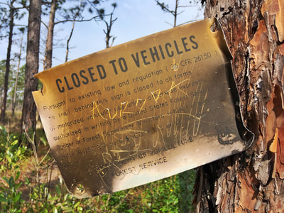 Closed to Vehicles sign in Croatan National Forest