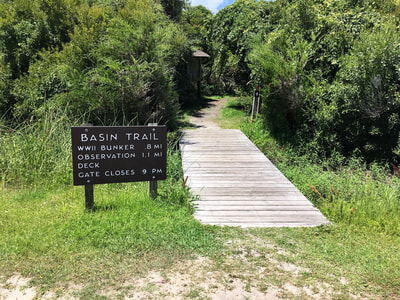 The start of the salt marsh basin trail at Fort Fisher