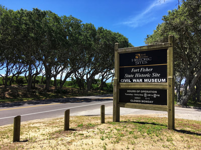 The entrance sign to the Fort Fisher State Park visitor's center.