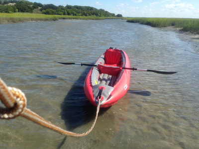 Pulling our kayak at low tide on the paddle route to Bear Island, North Carolina