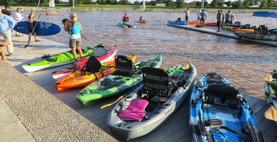 Kayaks along the river at demo day at this year's Paddlesports Retailer Show.
