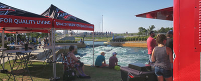 Hanging out at the Coop Ale Works booth at Riversports Rapids at the Paddlesports Retailer demo day