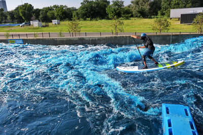 SUP on the whitewater at the Riversport Rapids facility in Oklahoma City