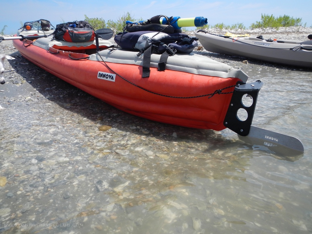 An Innova Helios inflatable kayak on the beach at Hammock's Beach State Park