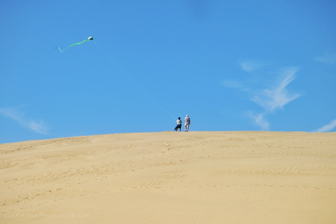 Flying a kite on the large sand dune at Jockey's Ridge State Park